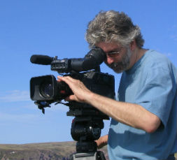 Cameraman Chris Murphy shooting whales and icebergs on the Bacclieu Trail in Newfoundland